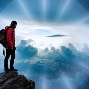 Man on mountain enjoying the views; 10 Ways to Build Resilience